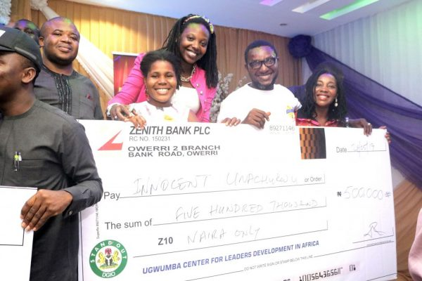 Innocent-Unachukwu-the-star-prize-winner-of-N500K-at-the-UEC-Owerri-Edition-displaying-his-cheque-1024x683